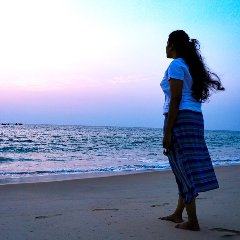 Girl Standing in Beach